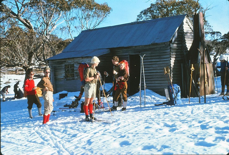 Harry Black (left foreground) and Gary Medaris (right foreground) at Broken Dam Hut, in 1975 when wool socks were the height of ski fashion, by Alan Vidler
