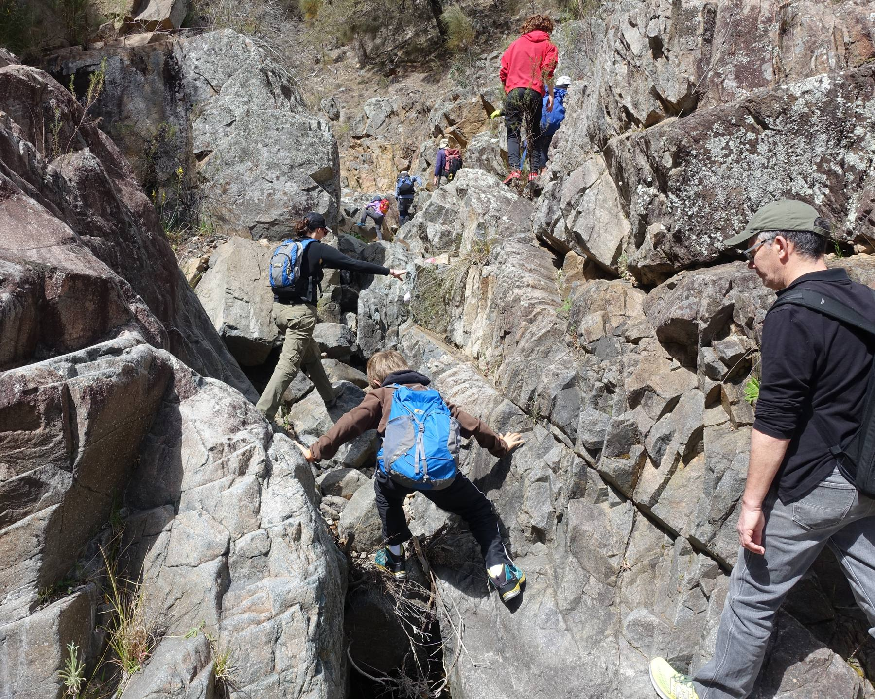 Older kids learning rock scrambling skills, Rob Roy almost-canyon, ACT, by Meg McKone