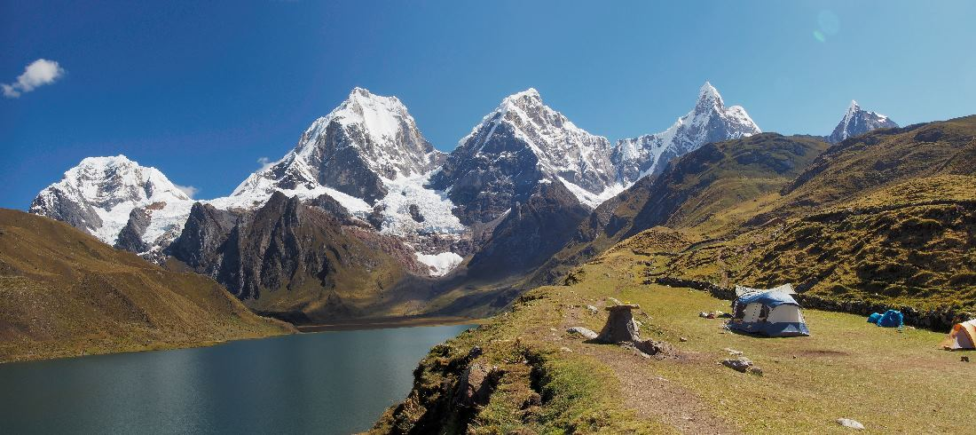 Lake Carhuacocah below Yerupaja, the 2nd highest peak in Peru, by Llewellyn Sibley